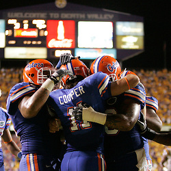 Oct 10, 2009; Baton Rouge, LA, USA; Florida Gators wide receiver Riley Cooper (11) celebrates with teammates after scoring a touchdown in the second quarter against the LSU Tigers at Tiger Stadium. Mandatory Credit: Derick E. Hingle-US PRESSWIRE