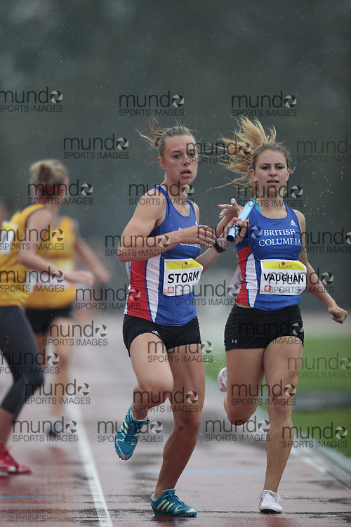 Ottawa, Ontario ---10-08-08--- Vaughn and Storm competes in the 4 X 400 metres at the 2010 Royal Canadian Legion Youth Track and Field Championships in Ottawa, Ontario August 8, 2010..GEOFF ROBINS/Mundo Sport Images.