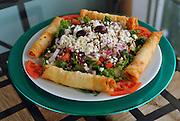 Sigara Borek and Greek salad served at Mavi in Mount Sinai N.Y.