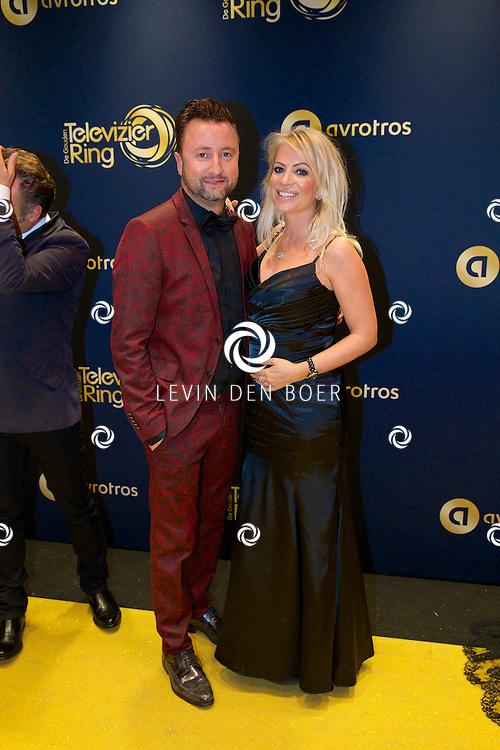 AMSTERDAM - In Theater Carré is de Gouden Televizier-Ring Gala 2014 gehouden. Velen bekende Nederlanders kwamen over de gouden loper. Met hier op de foto  Dennis Weening met partner Stella Maassen. FOTO LEVIN DEN BOER - PERSFOTO.NU
