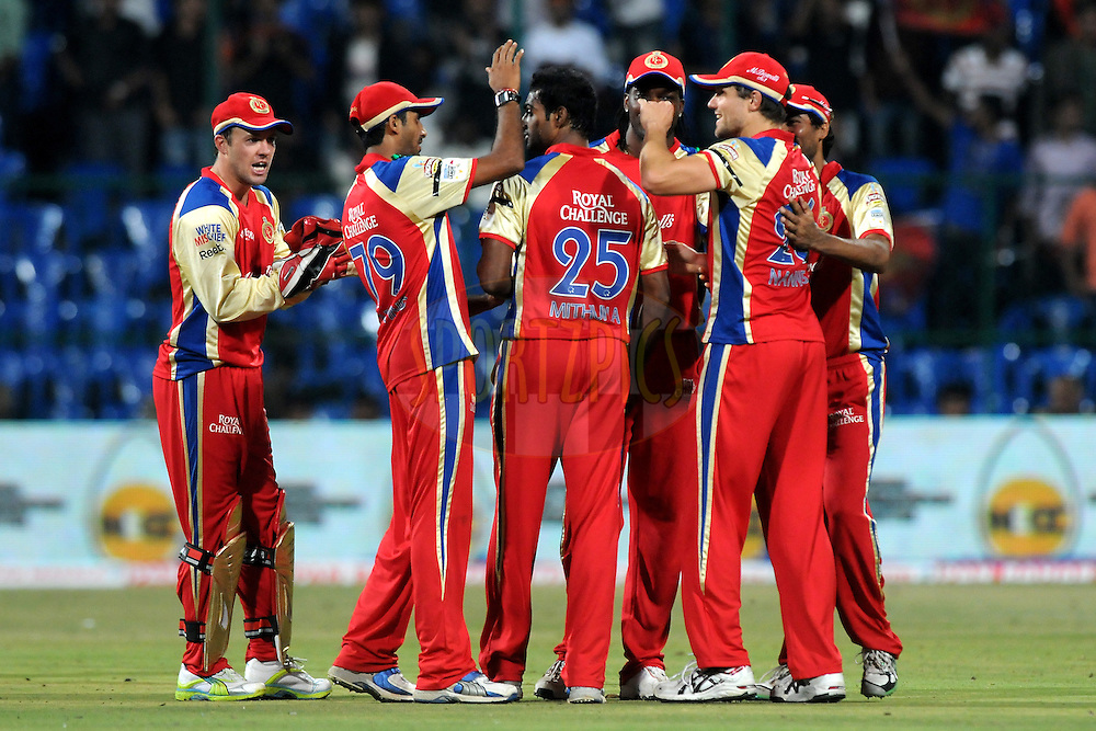 Team Royal Challengers Bangalore celebrate a wicket during match 1 of the NOKIA Champions League T20 ( CLT20 )between the Royal Challengers Bangalore and the Warriors held at the  M.Chinnaswamy Stadium in Bangalore , Karnataka, India on the 23rd September 2011..Photo by Pal Pillai/BCCI/SPORTZPICS