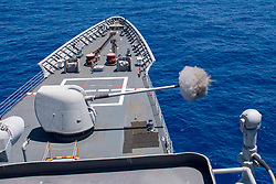 EAST CHINA SEA (Aug. 21, 2018) A Mark 45 5-inch gun weapon system fires ordinance during a live-fire weapon training exercise aboard the Ticonderoga-class guided-missile cruiser USS Antietam (CG 54).<br /> Antietam is forward-deployed to the U.S. 7th Fleet area of operations in support of security and stability in the Indo-Pacific region. (U.S. Navy photo by Mass Communication Specialist 2nd Class William McCann/Released)180821-N-HE318-1064