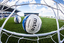 Footballs in the net during the warm up. The Falkirk Stadium, with the new pitch work for the Scottish Championship game v Morton. The woven GreenFields MX synthetic turf and the surface has been specifically designed for football with 50mm tufts compared with the longer 65mm which has been used for mixed football and rugby uses.  It is fully FFA two star compliant and conforms to rules laid out by the SPL and SFL.<br /> &copy;Michael Schofield.