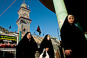 Women pass by the Kadhimiya Shrine in Baghdad.