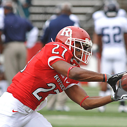 Sep 12, 2009; Piscataway, NJ, USA;  Rutgers cornerback Wayne Warren (27) makes a catch during warmups before Rutgers' 45-7 victory over Howard in NCAA College Football at Rutgers Stadium.
