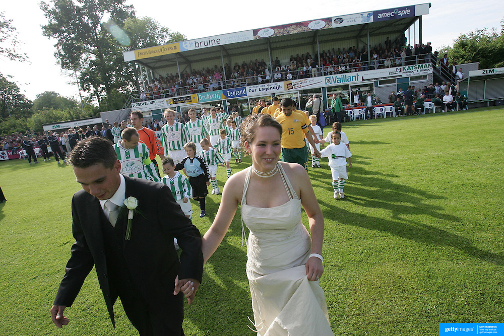 soccer  Australia V .V. Kloetinge  Newly weds Joffrey Geldof and Maaike van Damme who led the teams onto the field, posed for pictures with the teams and kicked off the match.   020606 Tim Clayton SMH Sport..soccer  Australia V .V. Kloetinge  Newly weds Joffrey Geldof and Maaike van Damme who led the teams onto the field, posed for pictures with the teams and kicked off the match.   020606 Tim Clayton SMH Sport