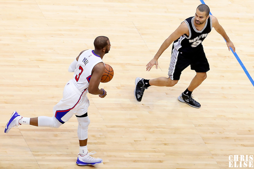 19 April 2014: Los Angeles Clippers guard Chris Paul (3) brings the ball up court against San Antonio Spurs guard Tony Parker (9) during the Los Angeles Clippers 107-92 victory over the San Antonio Spurs, during Game One of the Western Conference Quarterfinals of the NBA Playoffs, at the Staples Center, Los Angeles, California, USA.