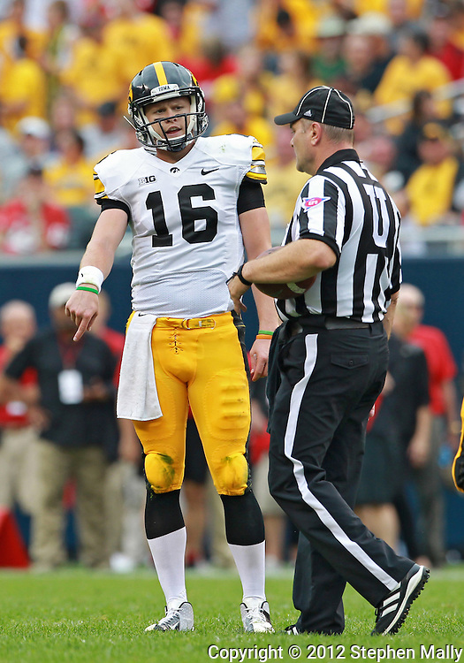 September 01 2012: Iowa Hawkeyes quarterback James Vandenberg (16) questions a call by the official during the first half of the NCAA football game between the Iowa Hawkeyes and the Northern Illinois Huskies at Soldiers Field in Chicago, Illinois on Saturday September 1, 2012. Iowa defeated Northern Illinois 18-17.
