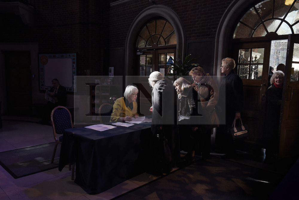 """© London News Pictures. """"Looking for Nigel"""". A body of work by photographer Mary Turner, studying UKIP leader Nigel Farage and his followers throughout the 2015 election campaign. PICTURE SHOWS - Elderly members of UKIP arrive at the party's major speech on immigration at the Emmanuel Centre in Westminster, London on March 3rd 2015. Mr Farage shocked many core UKIP voters at the time by suggestion that he would not put a specific cap on immigration. . Photo credit: Mary Turner/LNP **PLEASE CALL TO ARRANGE FEE** **More images available on request**"""