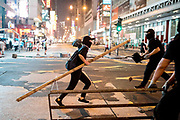 HONG KONG: 13 October 2019 <br /> Protesters build a road block as running battles between protesters and riot police continued today as demonstrators move into their 19th consecutive week of protests in Hong Kong. The movement's aim, which started on June 1st, originally wanted to get rid of a controversial extradition bill which has since been removed, however the protests have formed into a wider fight against police brutality and the ability to wear a mask without fear of arrest.<br /> Rick Findler / Story Picture Agency
