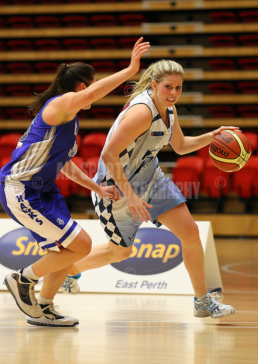PERTH, AUSTRALIA - JULY 16: Melissa Marsh of the Tigers drives to keyway against Gabby Clayton of the Hawks during the week 18 SBL game between the Perry Lakes Hawks and the Willetton TIgers at The State Basketball Center on July 16, 2011 in Perth, Australia.  (Photo by Paul Kane/All Sports Photography)
