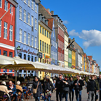 People Walking along Nyhavn in Copenhagen, Denmark <br />