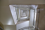 stairwell in a high rise building looking up