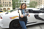 Kristhle Hernandez holds a new Hot Wheels Star Wars First Order Stormtrooper character car after taking a free Uber ride in a Dodge vehicle modeled after the toy, Friday, Sept. 4, 2015 in New York, to celebrate Force Friday.