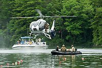 "The Navy Seal Team prepares to jump from their helicopter into Newfound Lake at Wellington State Beach during their mission demonstation following the ""Swim With a Mission"" event on Friday afternoon.  (Karen Bobotas/for the Laconia Daily Sun)"