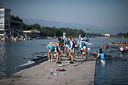 Plovdiv BULGARIA. 2017 FISA. Rowing World U23 Championships. <br /> Italian Crews, leaving the pontoon. Friday Boat Area. Boat Racks Pontoons.<br /> Friday Boat Area. Boat Racks Pontoons.<br /> <br /> 08:19:45  Friday  21.07.17   <br /> <br /> [Mandatory Credit. Peter SPURRIER/Intersport Images].