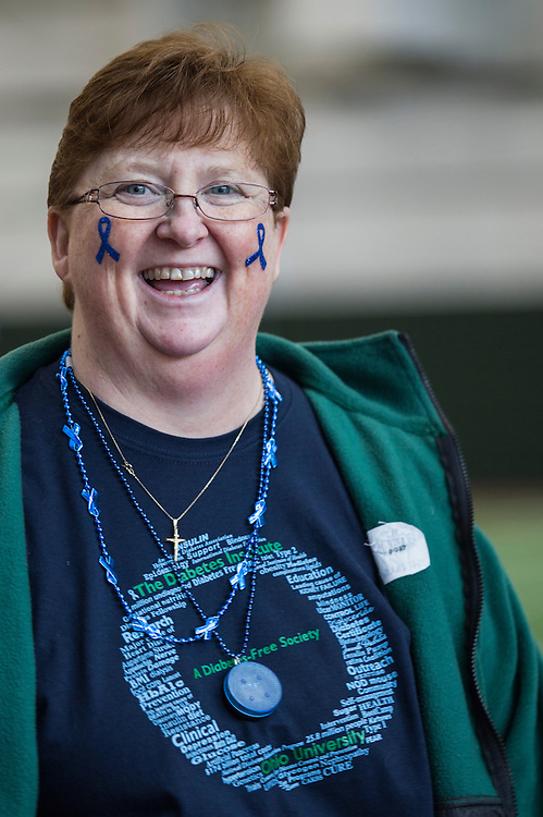 Cheryl Howe laughs as students and faculty begin to arrive at the Blue Circle for Diabetes event at the Walter Fieldhouse at Ohio University on Friday, November 14, 2014.