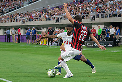 July 31, 2018 - Minneapolis, Minnesota, U.S - Milan's MATEO MUSACCHIO (22) clears the ball from GEORGES-KEVIN NKOUDOU in the first half. (Credit Image: © Keith R. Crowley via ZUMA Wire)
