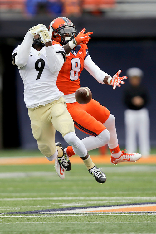 Purdue defensive back Anthony Brown (9) breaks up a pas intended for Illinois wide receiver Geronimo Allison (8) during the first half of an NCAA college football game at Memorial Stadium Saturday, Oct. 4, 2014, on the University of Illinois campus in Champaign, Ill. (Lee News Service/ Stephen Haas)