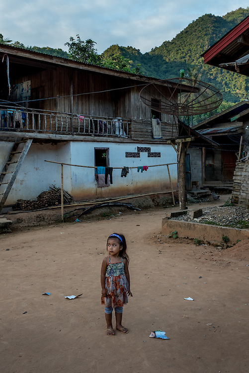 A girl in the village of Khoc Kham. The village is not connected to the main electrical grid and many residents operate their own turbines to power lights and sometimes small appliances.