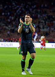 BELGRADE, SERBIA - Sunday, June 11, 2017: Wales' Sam Vokes applauds the travelling supporters after the 1-1 draw with Serbia during the 2018 FIFA World Cup Qualifying Group D match between Wales and Serbia at the Red Star Stadium. (Pic by David Rawcliffe/Propaganda)