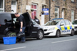 © Licensed to London News Pictures. 05/09/2016. Keighley UK. Picture shows police at a property where a Man aged 48 & a woman aged 29 where arrested on suspicion of explosives offences & detained for questioning by police from the North East Counter Terrorism Unit. Officers from the Counter Terrorism Unit (CTU) discovered potentially explosive material during searches as part of an ongoing enquiry at an address in Parkwood Street in the town at about 9.30pm yesterday and the Army's Bomb Disposal Unit from Catterick attended.  Photo credit: Andrew McCaren/LNP
