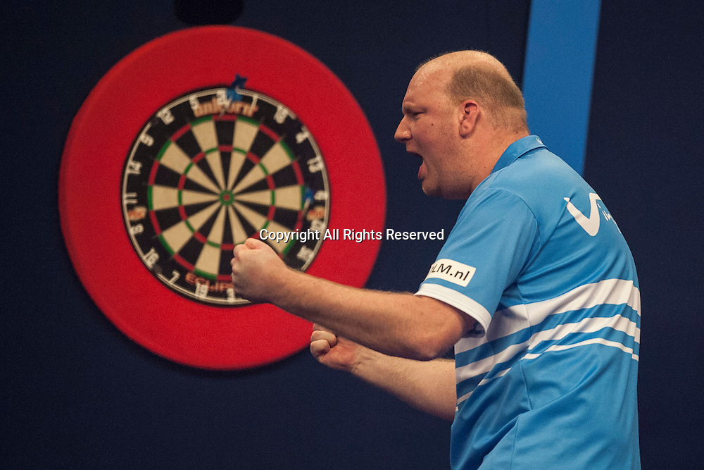 30.12.2014.  London, England.  William Hill PDC World Darts Championship.  Vincent van der Voort (23) [NED] celebrates the winning double in his match against Dean Winstanley (26) [ENG]. Vincent van der Voort won the match 4-2.