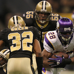 Jan 24, 2010; New Orleans, LA, USA; Minnesota Vikings running back Adrian Peterson (28) runs past New Orleans Saints linebacker Scott Fujita (55) and cornerback Jabari Greer (32) during a 31-28 overtime victory by the New Orleans Saints over the Minnesota Vikings in the 2010 NFC Championship game at the Louisiana Superdome. Mandatory Credit: Derick E. Hingle-US PRESSWIRE
