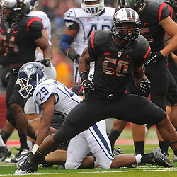 Oct 6, 2012: Rutgers Scarlet Knights linebacker Quentin Gause (50) celebrates after tackling Connecticut Huskies cornerback Taylor Mack (29) on a kickoff during second half NCAA college football action between the Rutgers Scarlet Knights and UConn Huskies at High Point Solutions Stadium in Piscataway, N.J.