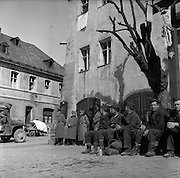 April 1945, Germany. Russian soldiers, just liberated by Allied troops, after being works as slave laborers by the Nazis. German officer prisoners in the background.