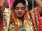 Travel photography of an Indian woman in traditional sari dress Photographed in Ladakh, Jammu and Kashmir, India