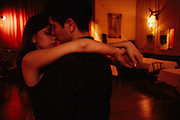Facundo y Maggie in Ni&ntilde;o Bien. Facundo was getting ready to travel to Japan and they were spending their last night together dancing tango.<br /> <br /> Between 1865 and 1914 the population of Buenos Aires swelled from 150.000 to 1.5 million. The bulk of this contingent was made up of immigrants from Europe, Italy in particular. At the beginning of the 20th century, in the slums and in the red light districts, there occurred a fusion of all the musical traditions of immigrants, natives, original Spanish settlers and Black slaves. Something completely new was born &ndash;the tango. Blacks brought the syncopated rhythms and the proximity of the bodies, Jewish settlers added the violin, German immigrants the bandoneon, Italians the haunting melodies of Sicily, and Spanish, the sometimes joyful, sometimes mournful intensity of the Andalucian tango, a form of canto flamenco.