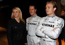 STUTTGART, GERMANY - Monday, January 25, 2010: Drivers Michael Schumacher with his wife Corinna Betsch and team-mate Nico Rosberg pose during the Mercedes GP Petronas Formula One Team presentation at the Mercedes-Benz Museum. (Pic by Juergen Tap/Hoch Zwei/Propaganda)