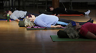 Middletown, New York - Women relax at the end of a yoga class led by Maria Blon of Create Your Wellness at the First Presbyterian Church on April 21, 2011.