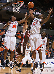 Virginia forward Jamil Tucker (12) grabs a rebound from Brown center Stefan Kaluz (50).  The Virginia Cavaliers defeated the Brown University Bears 74-50 in NCAA Basketball at the John Paul Jones Arena on the Grounds of the University of Virginia in Charlottesville, VA on January 6, 2009.
