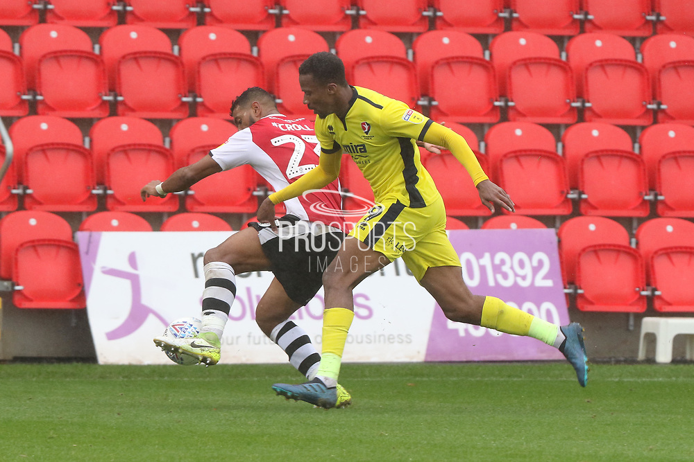 Luke Croll and Manny Duku during the EFL Sky Bet League 2 match between Exeter City and Cheltenham Town at St James' Park, Exeter, England on 22 September 2018.