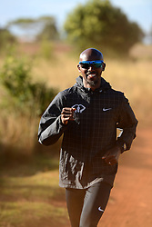 © Licensed to London News Pictures. Iten, Kenya. Double world and Olympic champion MO FARAH in training at an altitude training camp based at 2,500m in Iten, Kenya, ahead of the 2014 Virgin Money London Marathon in April this year. The Somalia born, adopted Brit, is looking to make the jump from the 10,000m distance to a full marathon for the first time in front of a home crowd. Photo credit : Mike King/LNP