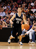 Apr. 11, 2011; Phoenix, AZ, USA; Minnesota Timberwolves guard Luke Ridnour (13) handles the ball against the Phoenix Suns at the US Airways Center. The Suns defeated the Timberwolves 135 -127 in overtime. Mandatory Credit: Jennifer Stewart-US PRESSWIRE
