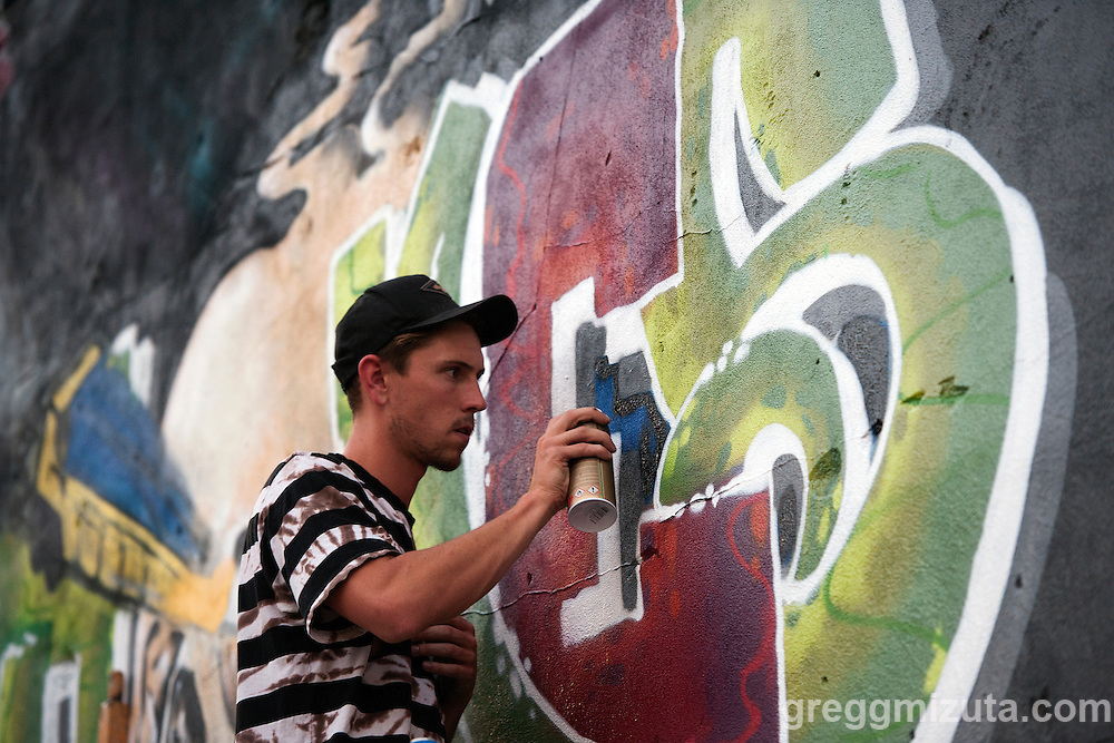Josh Parke works on his mural in the evening of August 11, 2016 during the Freak Alley Gallery sixth annual mural event in downtown Boise, Idaho.<br /> <br /> His mural is a dedication piece for his mother in law who just passed away. He is bringing her nickname &quot;Bones&quot; together with some of her favorite colors. Josh says, &quot;The piece is for her. She can't be here but this can&quot;.<br /> <br /> Freak Alley Gallery's week long event provided an &quot;art-in-motion&quot; experience as it welcomed the public to watch artists work on their murals.