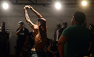 Artist participate in a dance off during a competition at an underground community art space in Jackson, Miss.