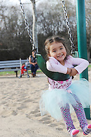 Yamilet Moreno, 3, just hangin' out on the swings at Natividad Creek Park on Sunday in Salinas.