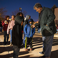 Sammy Chioda holds a mic for David Sanchez, 7, as he sings Jingle Bells to the crowd before the tree lighting at the McKinley County Courthouse Square, Saturday Nov. 24 in Gallup.