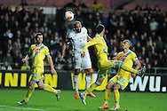 Swansea city's Ashley Williams goes close to scoring with this header. UEFA Europa league match , Swansea city v Napoli at the Liberty Stadium in Swansea, South Wales on Thursday 20th Feb 2014. pic by Andrew Orchard, Andrew Orchard sports photography.
