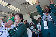 Connie Lawson-Davis, right, a member of the OUAA board of directors, cheers at the beginning of the Ohio University Homecoming football game on October 10, 2015 at Peden Stadium. Photo by Emily Matthews