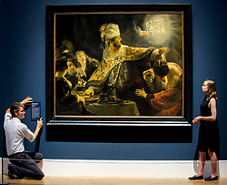 Senior Curator of Northern European Art with the 1national 1galleries of Scotland, Dr Tico Seifert (left)  puts the finishing touches to the name plate for one of the priceless paintings by Rembrandt, watched by Gallery curator Matilda Sandahl.<br /> <br /> &copy; Dave Johnston / EEm