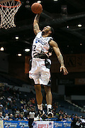 Haakim Johnson of the Razorsharks dunks on a breakaway during a game against the Carolina Vipers at the Blue Cross Arena on Saturday, December 6, 2014.