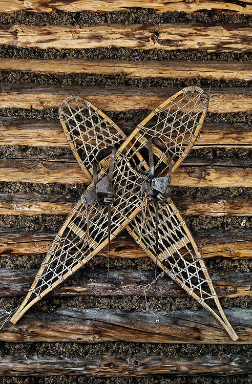Traditional snow shoes worn by the Athabascan indians hanging on a log cabin wall, Chena Indian Village, Alaska