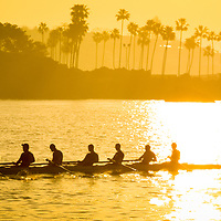 Newport Beach Rowing Crew Panorama Photo. The rowing team is in Newport Bay (Newport Harbor) in Newport Beach California with Corona Del Mar in the background. Newport Beach is an affluent coastal city along the Pacific Ocean in Orange County Southern California.