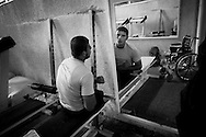 Mahumod Abu Ghanima 22 years old trains in the Palestine stadium gym.