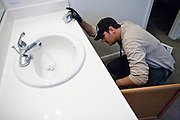 SACRAMENTO, CA - DECEMBER 2:   NorthWoods inspector Manny Nevarez checks for leaks in a foreclosed home in Sacramento, California December 2, 2008. Many foreclosed homes need substantial repairs before going on the market. (Photo by Max Whittaker/Getty Images)